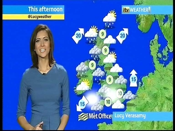 Lucy Verasamy wears blue dress